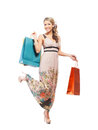 Young blond woman holding shopping bags and attractive caucasian in a colorful dress the image is isolated on a white background Stock Photography