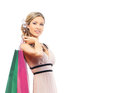 A young blond woman holding shopping bags and attractive caucasian in colorful dress the image is isolated on white background Royalty Free Stock Photos