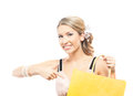 A young blond woman holding a yellow shopping bag and attractive caucasian the image is isolated on white background Royalty Free Stock Photography