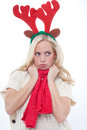 Young blond woman with horns pouts Royalty Free Stock Photos