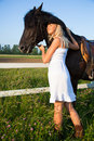 Young blond woman with horse Royalty Free Stock Photo