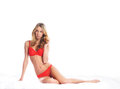 A young blond woman laying in red lingerie Royalty Free Stock Photography