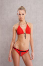 A young blond woman posing in a red swimsuit Royalty Free Stock Photos