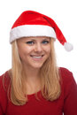 Young blond woman in santa hat Stock Photography