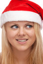 Young blond woman in santa hat Royalty Free Stock Images