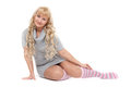 Young blond woman sitting on a floor Royalty Free Stock Photos