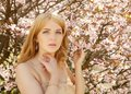 Young blond woman smelling flowers Royalty Free Stock Photo