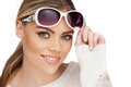 Young blond woman with sunglases studio white Royalty Free Stock Photo