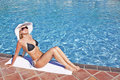 Young blond woman at swimming pool Royalty Free Stock Photo