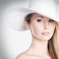 A young blond woman in a white hat Royalty Free Stock Image