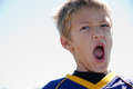 Young blonde boy yelling Royalty Free Stock Photo