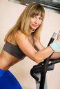 Young blonde exercising on stepper equipment Stock Photography