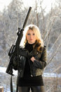 Young blonde with a gun Stock Images