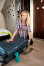 Young blonde packing travel bag Royalty Free Stock Photos