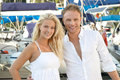 Young blonde and pretty couple on summer holidays with her sailing boat Royalty Free Stock Image