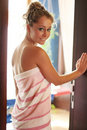 Young blonde stands in a door Royalty Free Stock Photo