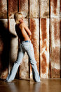 Young blonde woman in blue jeans Stock Images