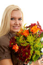 Young blonde woman with bouquet of flowers Royalty Free Stock Images