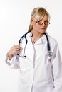 Young blonde woman doctor on white background Stock Images