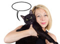 Young blonde woman holding a cat with thought cloud on white isolated background. Royalty Free Stock Photo