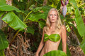 Young blonde woman posing with banana leaves Royalty Free Stock Photo