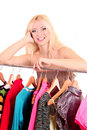 Young blonde woman select dress Stock Photo