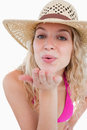 Young blonde woman sending an air kiss Royalty Free Stock Image
