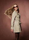 Young blonde woman in topcoat. Royalty Free Stock Image