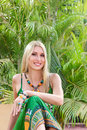 Young blonde woman at tropical resort Stock Photos