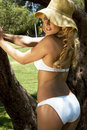 Young blonde woman in white bikini Royalty Free Stock Photography