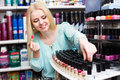 Young blondie selecting lipstick Royalty Free Stock Photo