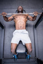 Young bodybuilder doing weightlifting in the crossfit gym Stock Image