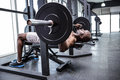 Young Bodybuilder doing weightlifting Royalty Free Stock Photo