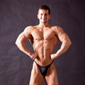 Young bodybuilder posing in studio Royalty Free Stock Image