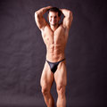 Young bodybuilder posing in studio Royalty Free Stock Images