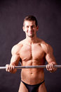 Young bodybuilder traininig Stock Photo