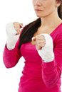 Young boxer woman with white bandage on hands over white background Stock Images