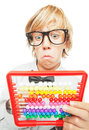 Young boy with abacus calculator Royalty Free Stock Photo