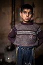 Young boy aleppo syria a stands in his one room family home in a rebel held district of a kettle on the stove in the Stock Images