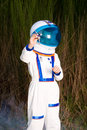 Young boy in an astronaut suit flying toy plane Royalty Free Stock Image