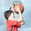 Young boy in basketball who having fun a play Stock Image