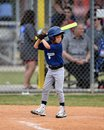 Young Boy batting during a Little League baseball game Royalty Free Stock Photo