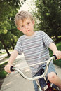 Young boy on a bike Royalty Free Stock Photos