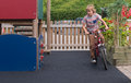 Young boy on bike white male child in play area Royalty Free Stock Photos