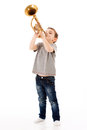 Young boy blowing into a trumpet Royalty Free Stock Photo
