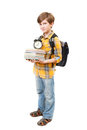 The young boy with books clock and knapsack Royalty Free Stock Photo