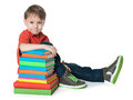 Young boy with books a portrait of a on the floor near the pile of on the white background Royalty Free Stock Photo