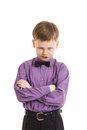 Young boy with a bow-tie looking angry isolated Royalty Free Stock Photo