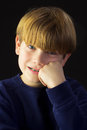 Young boy with braces a green and a resigned look Royalty Free Stock Photo