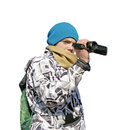 Young boy with camcorder on white background in winter jacket and blue hat Stock Photo